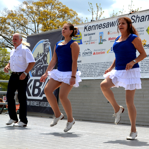 Three adults performing a dance routine