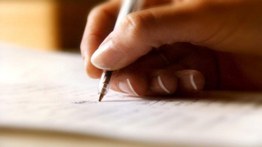 photo of pen in hand